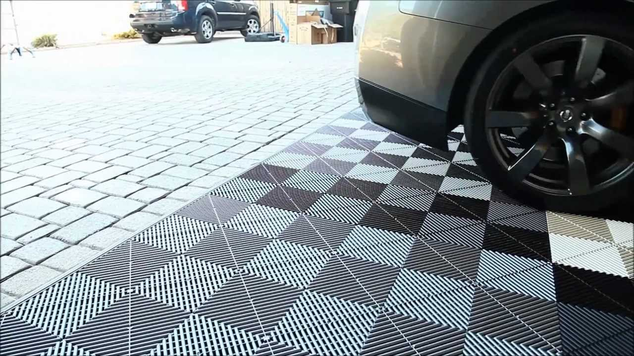 garage flooring inc installs vented xl modular flooring tiles youtube