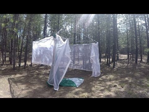 Off Grid Truck camper: wind storm blew up my canopy. Solar panels, lets go for a walk.