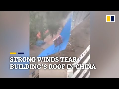 Strong winds tear building's roof in China