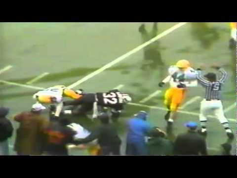 Oregon P/K Tommy Thompson does a great job avoiding the rush to get the punt away 11-21-92