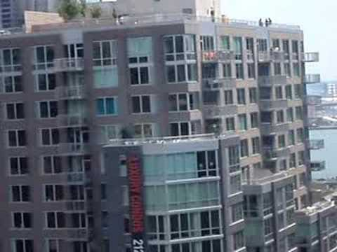 LiveLeak com   Update  Naked man takes naked woman hostage on roof