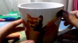 Показываю мягкую игрушку Кота в сапогах с кружкой из серии дримворкс из магнита