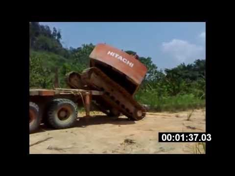 Amazing Loading Excavator on Busy Road in East Timor