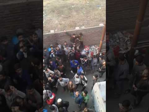 People gathered outside syed ali shah geelani residence