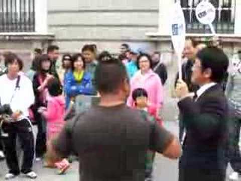 Japanese tourist guide try to sing in Madrid