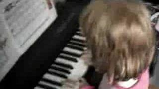 Jasmine playing piano