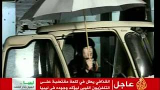 Moammar Gaddafi olding an umbrella during Libya genocide: Thank God its raining!!!