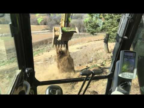 Digging footings in a fairly tight spot cat 320 excavator part 1