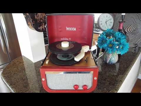 """Decca record player playing a stack of 45 RPM 7"""" records"""