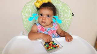 Baby Amira she tries not to eat the candy until I come back