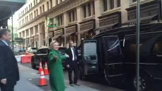 Sick Hillary Wears Heavy Winter Coat on Warm Afternoon