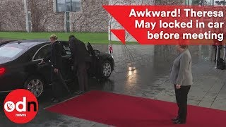 Theresa May locked in the car before crunch meeting with Angela Merkel