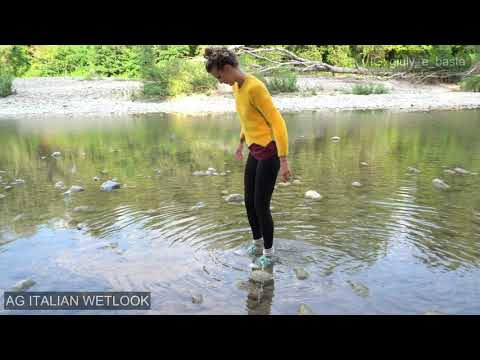 Wetlook - Giulia in the river with vintage sneakers, leggings and yellow sweater.