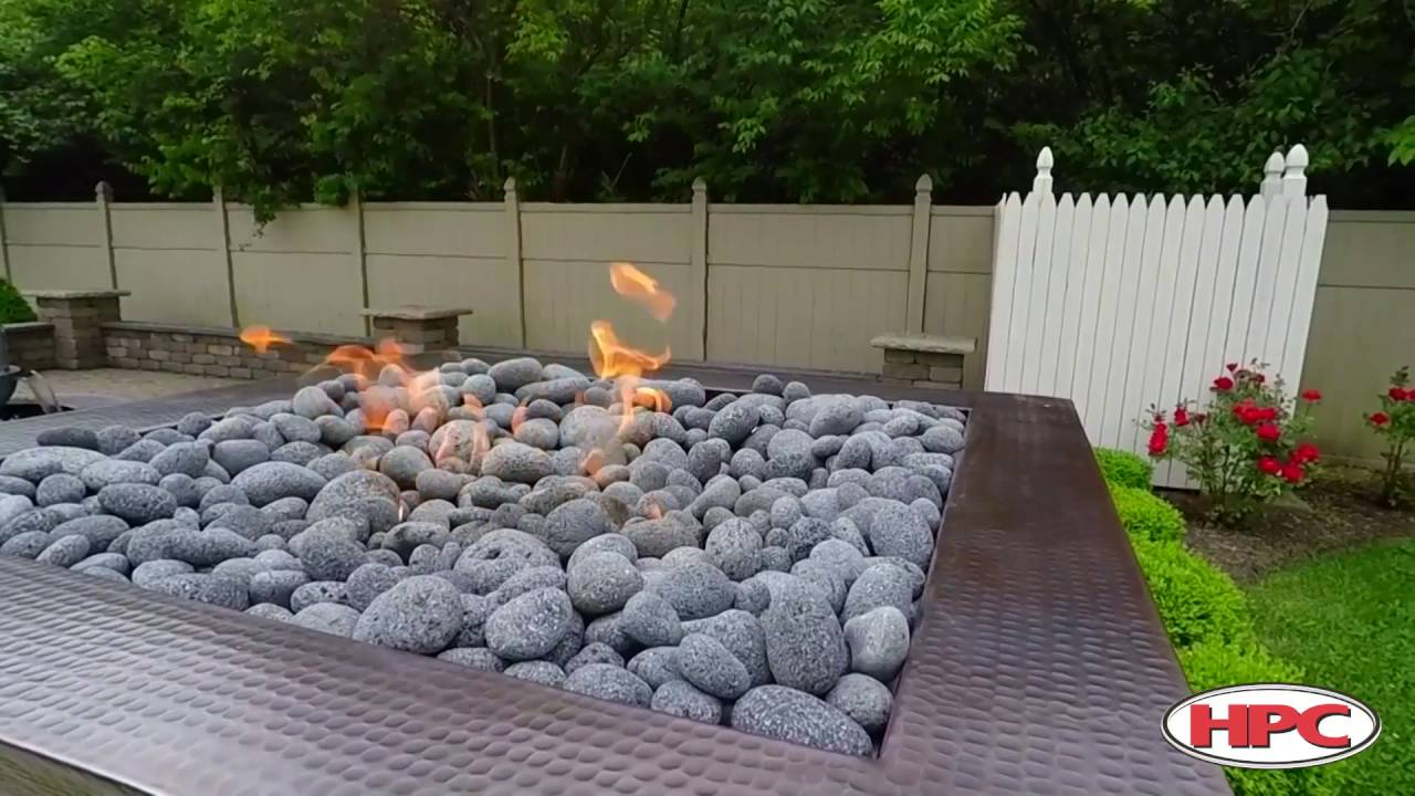 Outdoor fire pit rolled lava stone youtube for Lava rock pavers