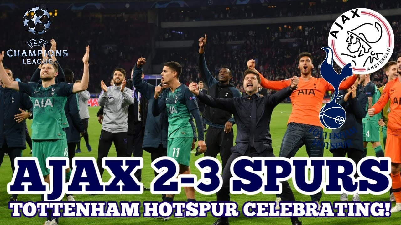 the tottenham players celebrating in the changing rooms