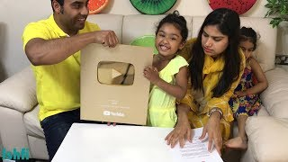 Ishfi's Gold Button Unboxing Moment