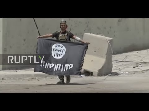 Iraq: Soldiers parade seized IS flags in Mosul after militants pushed out of city
