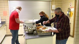 People preparing meals for veterans