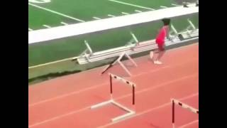 Girl running track. Girl falling over hurdles. Funny track meet.  The hurdles of life…