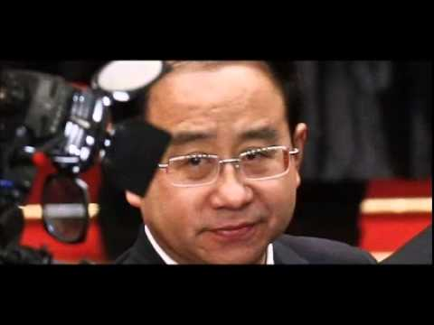 China charges former president's aide with corruption