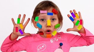 Alena and mom plays with Lego Toys on their Faces and Hands | Clap your hands