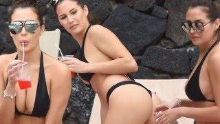 Chloe Goodman shows off her impressive bum as she soaks up the sun in a black bikini