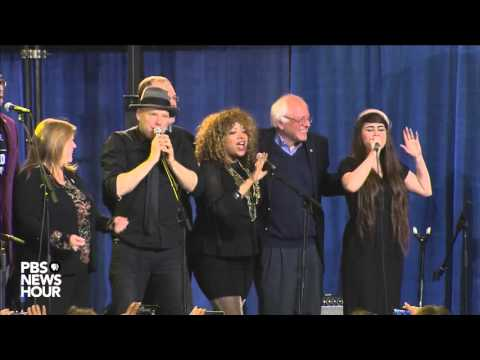 Sanders Sings 'This Land Is Your Land' With Band At Rally