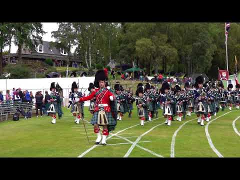 Braemar Gathering 2018 opening Parade by Ballater Pipe Band before Royal Highland Games committee