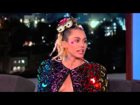 Miley Cyrus leaves Jimmy Kimmel flustered by wearing heart-shaped nipple pasties for chat show