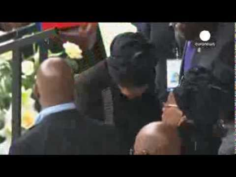 Mandela's widow Graca Machel and ex-wife Winnie's hug at memorial ceremony in Soweto