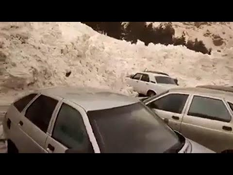 SCARY: Avalanche reaches parking lot, pushes cars, it just keeps going (ON CAM)