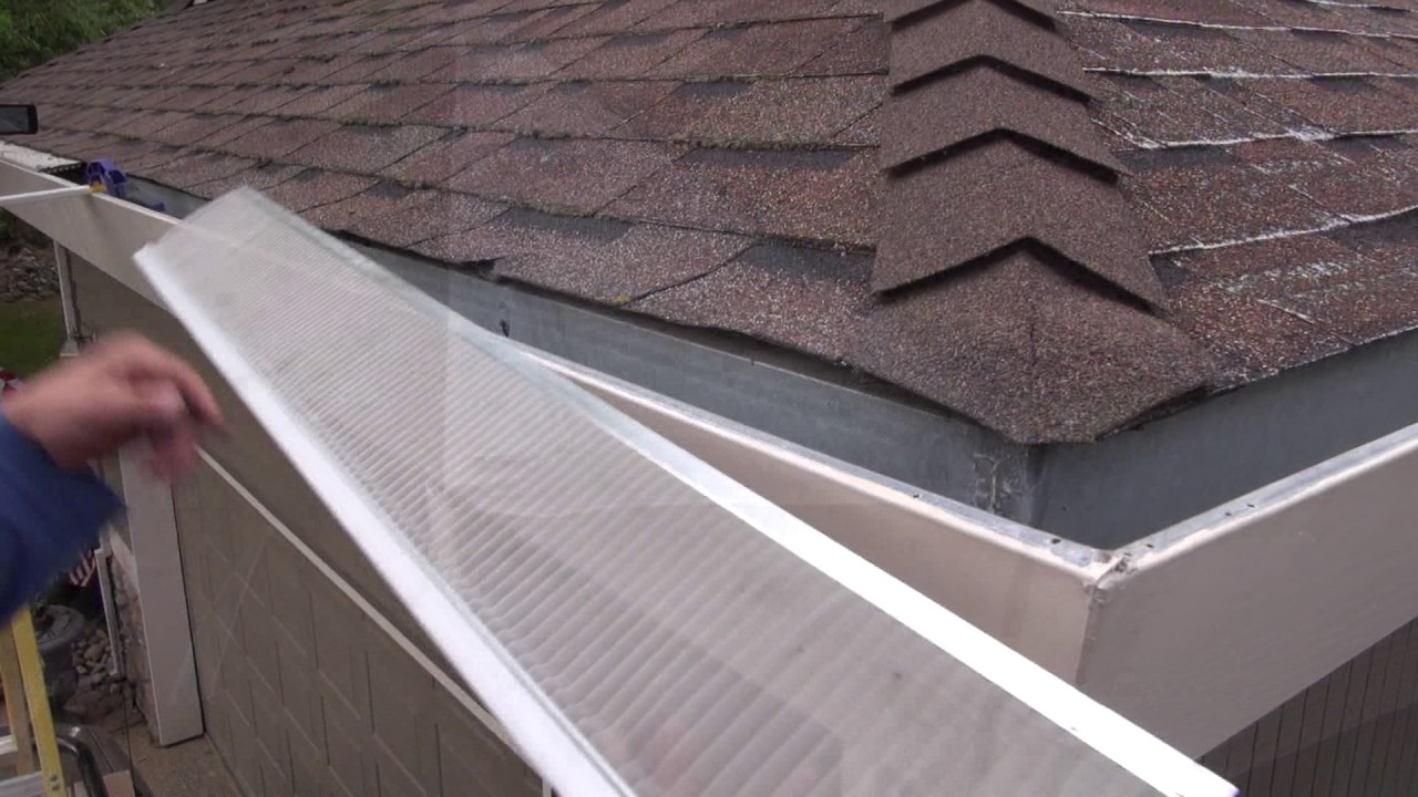 Installing Gutter Guards On An Asphalt Shingle Roof Youtube