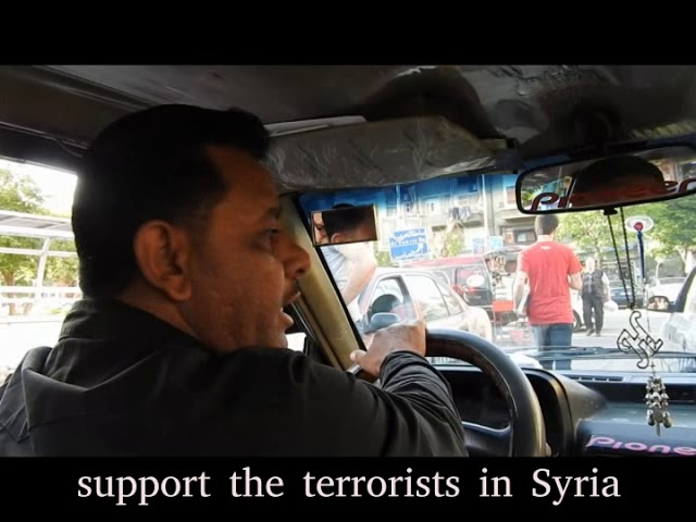 Palestinian soldier taxi driver on President Assad