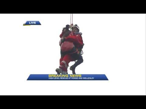 Video: Firefighters rescue woman stuck on crane in downtown Toronto