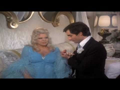 Mae West Timothy Dalton Sing Love Will Keep Us Together
