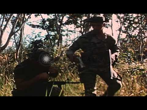 Soldiers of 1st Infantry Division of US Army in camouflaged tiger suit flop hat, ...HD Stock Footage