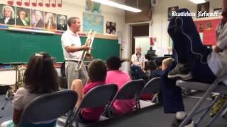 Elementary school music teacher Erin Villamizar, BAMS instrumental music teacher Tom Nasiatka and BU