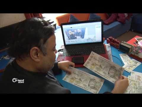 فنان فلسطيني من قطاع غزة ينجح في تصميم جنية وطني بدلا من العملة الإسرائيلية  - 09:20-2018 / 2 / 18