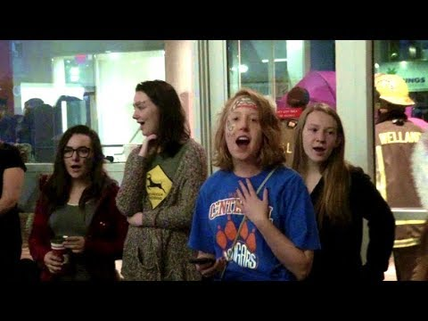 Students Flash Mob Rain Soaked Crowd with Beautiful Version of White Christmas