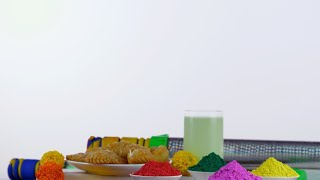 Pan shot of beautifully placed festive items for the joyful Indian festival - Holi