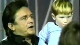 "Johnny Cash sings ""Jesus Loves Me"" to children"
