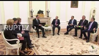 Russia: Putin greets new Moldovan pres. in Moscow, leaders tout resumption of ties