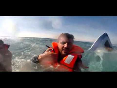 GOPRO - Migrant rescued from almost-fully submerged boat by Turkish coast guard