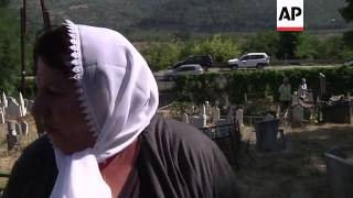 Muslims mark Eid by visiting graves of loved ones in tense Serb-run north