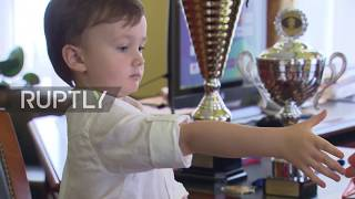 Check (out this) mate! 4-year old chess player takes on a grandmaster