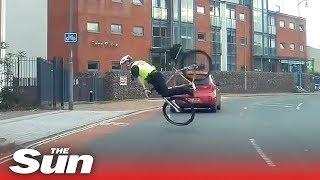 hapless-bike-cop-goes-flying-over-the-handlebars