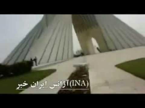 Burning picture of Khamenei at Azadi Square in Tehran - Iran 16 March 2010