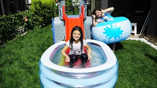 Masal and Öykü with playing fun water slide