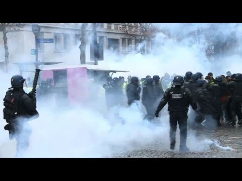 Riot police fire tear gas at 'yellow vest' protesters in Paris
