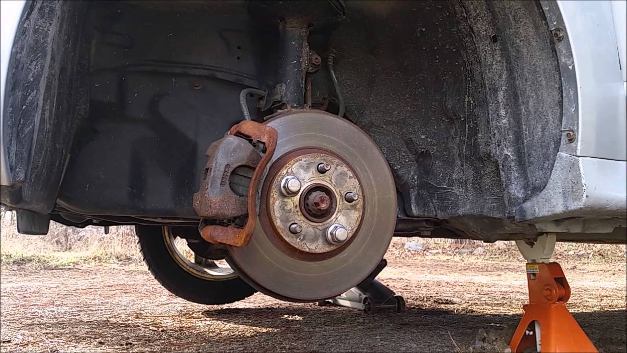 Brakes clunk when going from drive to reverse due to missing shims?